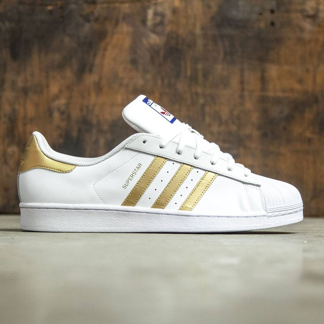 new concept e1248 25d85 Adidas Men Superstar white gold metallic blue