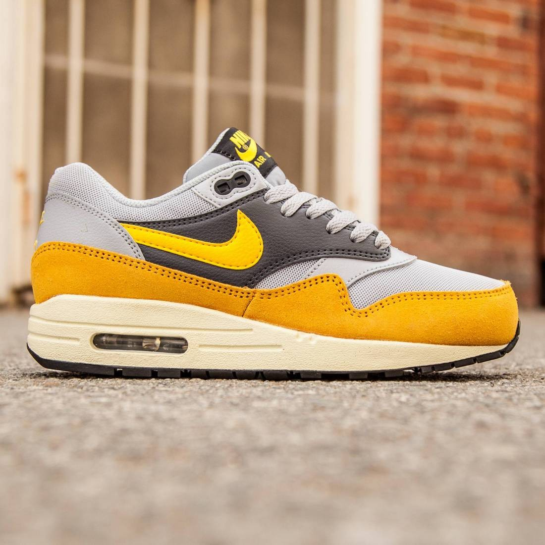 67fd0219daae4 Nike Women Air Max 1 Essential (gold   wolf grey   varsity maize   gold  leaf   dark grey)
