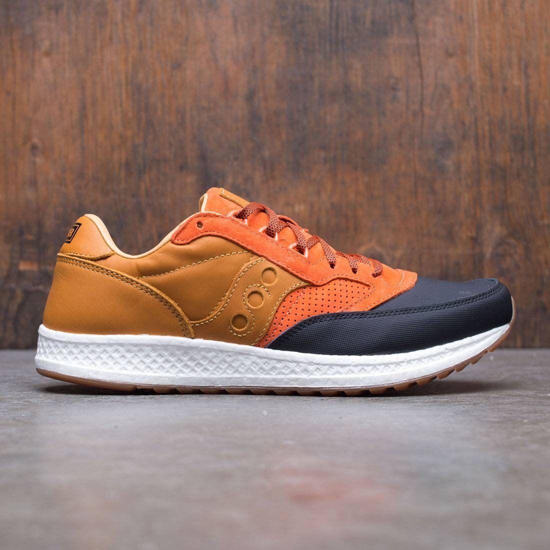 Saucony x Premier Men Freedom Runner - Stormlight (orange / black)