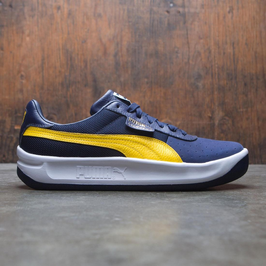 3b5a8304e5e4 Puma Men California Casual blue peacoat yellow