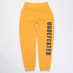 Undefeated Men Compact Sweatpants (gold)